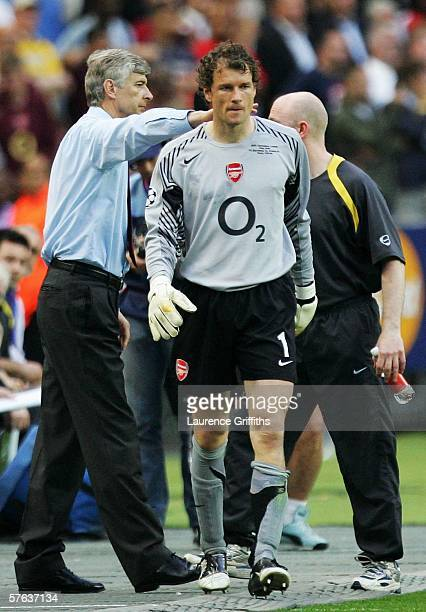 Jens Lehmann the Arsenal goalkeeper is consoled by his manager Arsene Wenger after he is sent off for fouling Samuel Eto'o of Barcelona during the...