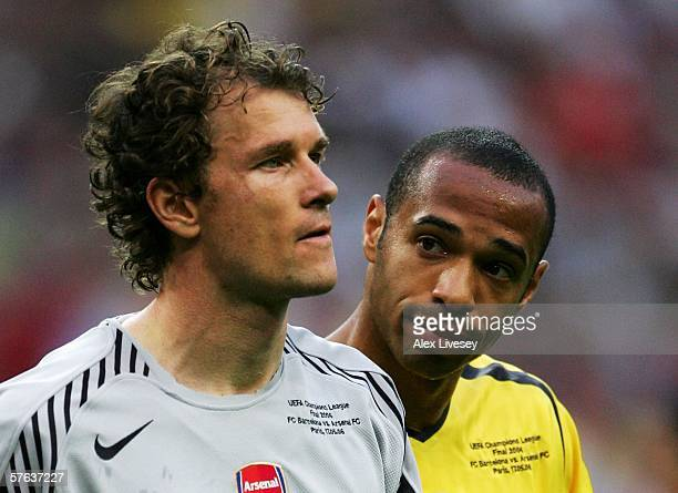 Jens Lehmann the Arsenal goalkeeper is consoled by Thierry Henry after he is sent off for fouling Samuel Eto'o of Barcelona during the UEFA Champions...