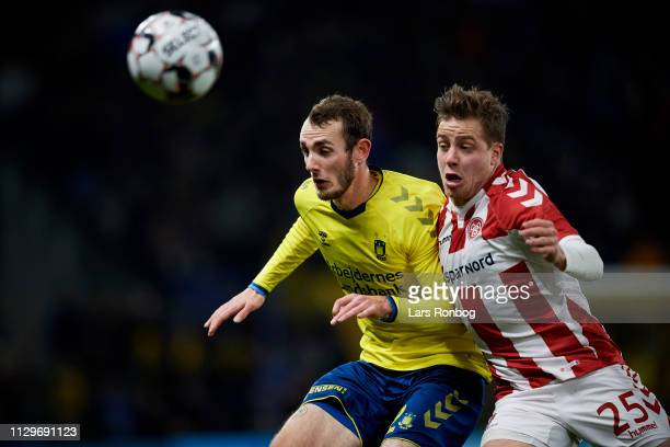 Jens Martin Gammelby of Brondby IF and Frederik Borsting of AaB Aalborg compete for the ball during the Danish Superliga match between Brondby IF and...