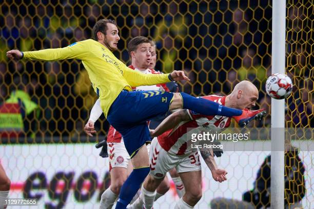 Jens Martin Gammelby of Brondby IF and Kasper Pedersen of AaB Aalborg compete for the ball during the Danish Superliga match between Brondby IF and...