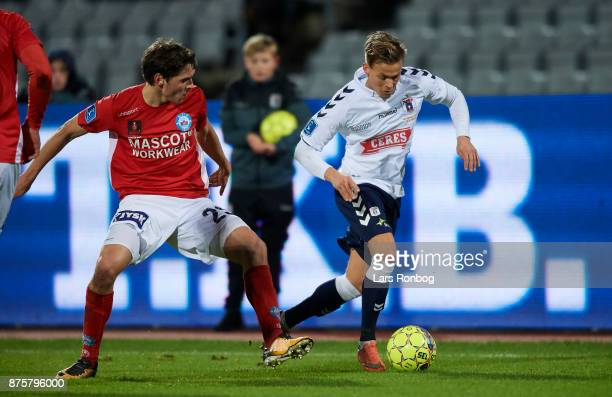 Jens Martin Gammelby of Silkeborg IF and 21$ compete for the ball during the Danish Alka Superliga match between AGF Aarhus and Silkeborg IF at Ceres...