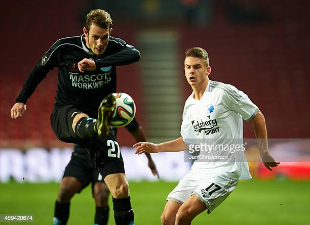 Jens Martin Gammelby of Silkeborg IF and Alex Kacaniklic of FC Copenhagen compete for the ball during the Danish Superliga match between FC...