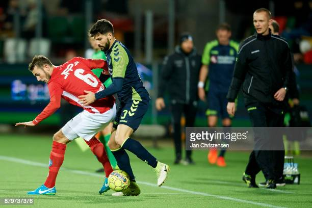 Jens Martin Gammelby of Silkeborg IF and Anthony Jung of Brondby IF compete for the ball during the Danish Alka Superliga match between Silkeborg IF...