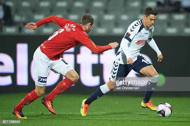 Jens Martin Gammelby of Silkeborg IF and Christopher Oikonomidis compete for the ball during the Danish Alka Superliga match between AGF Arhus and...
