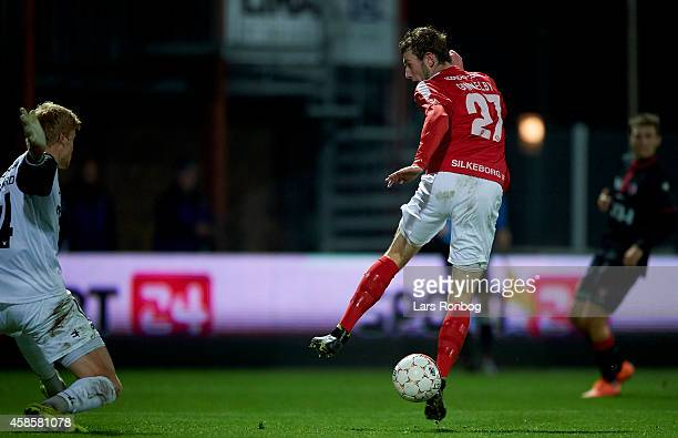 Jens Martin Gammelby of Silkeborg IF and Goalkeeper Jakob Haugaard of FC Midtjylland in action during the Danish Superliga match between Silkeborg IF...