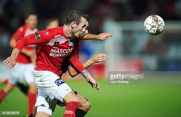 Jens Martin Gammelby of Silkeborg IF and Jakob Blabjerg of AaB Aalborg compete for the ball during the Danish Alka Superliga match between Silkeborg...