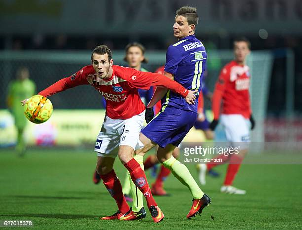 Jens Martin Gammelby of Silkeborg IF and Jonas Borring of FC Midtjylland compete for the ball during the Danish Alka Superliga match between...