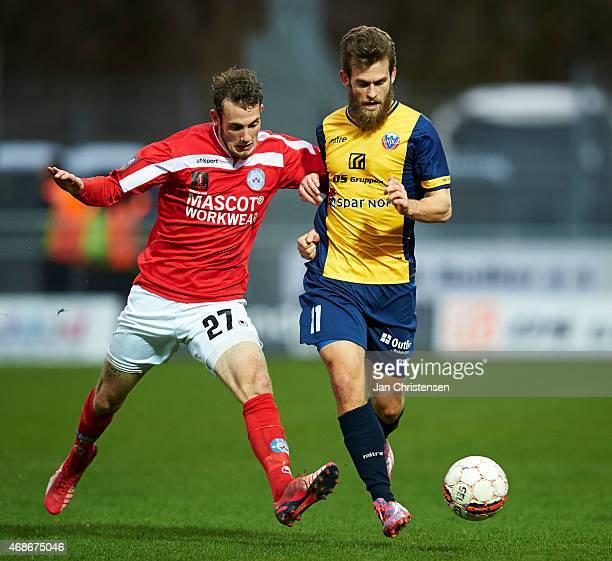 Jens Martin Gammelby of Silkeborg IF and Mads Jessen of Hobro IK compete for the ball during the Danish Alka Superliga match between Hobro IK and...
