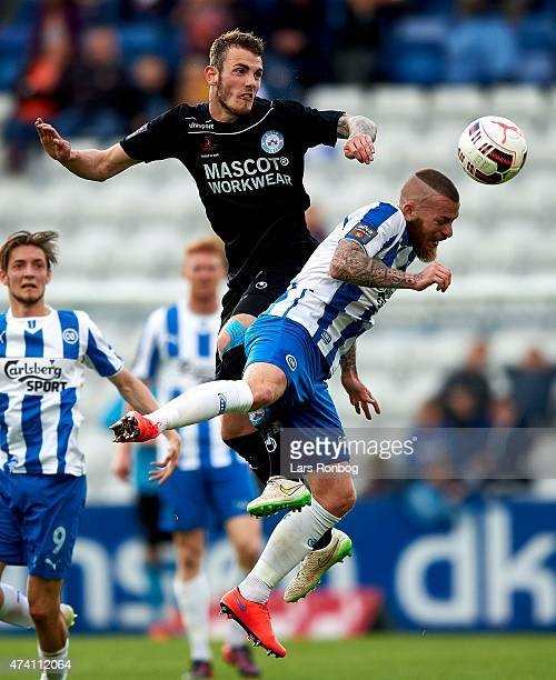Jens Martin Gammelby of Silkeborg IF and Martin Spelmann of OB Odense compete for the ball during the Danish Alka Superliga match between OB Odense...