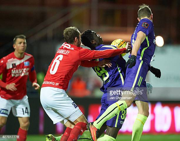 Jens Martin Gammelby of Silkeborg IF and Paul Onuachu of FC Midtjylland compete for the ball during the Danish Alka Superliga match between Silkeborg...