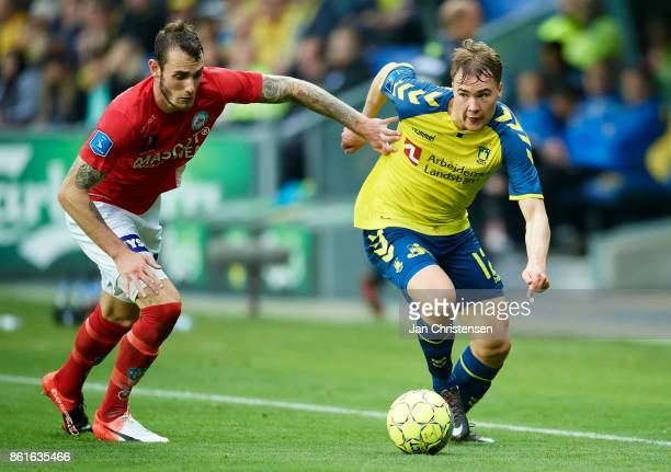Jens Martin Gammelby of Silkeborg IF and Simon Tibbling of Brondby IF compete for the ball during the Danish Alka Superliga match between Brondby IF...