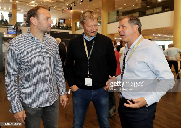 Jens Nowotny Guido Buchwald and Andreas Moeller talk during the Club of Former National Players Regional Meeting at Opel Arena on June 11 2019 in...