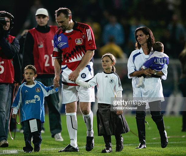 Jens Nowotny walks a lap of honour with his son Niklas and daughter Pia after the friendly match between Mein Sommermaerchen and KSC Friends at the...