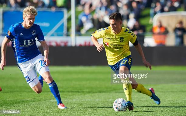 Jens Odgaard of Lyngby BK and Svenn Crone of Brondby IF compete for the ball during the Danish Alka Superliga match between Lyngby BK and Brondby IF...