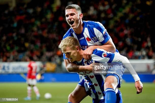 Jens Odgaard of SC Heerenveen celebrates 1-3 with Sven Botman of SC Heerenveen during the Dutch Eredivisie match between AZ Alkmaar v SC Heerenveen...