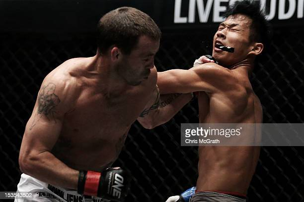 Jens Pulver of the USA connects with a left hand punch dislodging the mouth guard of Zhao Ya Fei of China during the One Fighting Championship,...