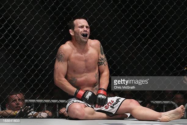 Jens Pulver of the USA reacts after being kicked in the groin by Zhao Ya Fei of China during the One Fighting Championship Bantamweight Grand Prix...