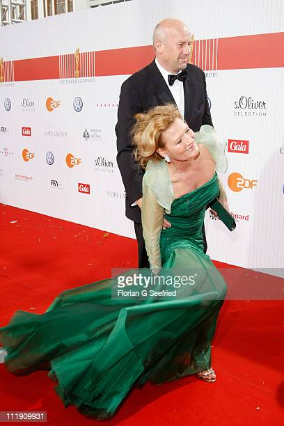 Jens Schniedenharn and actress Suzanne von Borsody arrive at the Red Carpet for the 'Lola - German Film Award 2011' at Friedrichstadtpalast on April...