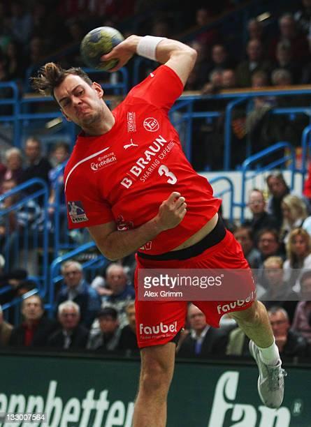 Jens Schoengarth of Melsungen throws the ball during the Toyota Handball Bundesliga match between T VGrosswallstadt and MT Melsungen at fan...