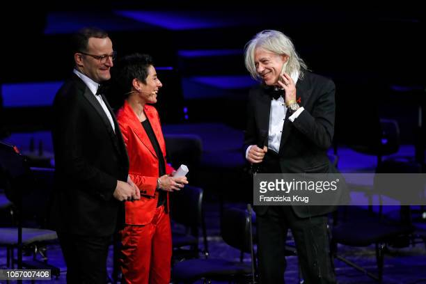 Jens Spahn and Dunja Hayali welcome Sir Bob Geldof on stage during the 25th Opera Gala at Deutsche Oper Berlin on November 3 2018 in Berlin Germany