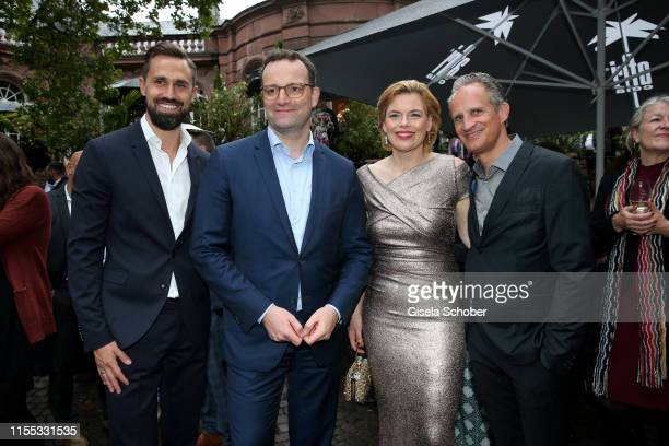 Jens Spahn and his husband Daniel Funke and Minister Julia Kloeckner and her husband Ralph Grieser during the opening of the Nibelungen Theatre...