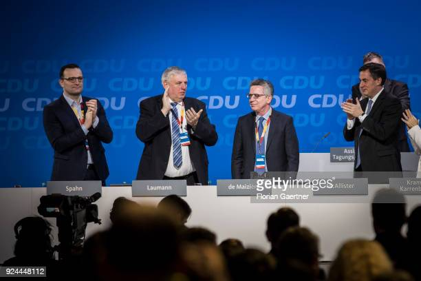 Jens Spahn KarlJosef Laumann and David McAllister clap their hands for the outgoing Minister of Interior Thomas de Maiziere at the 30th German...