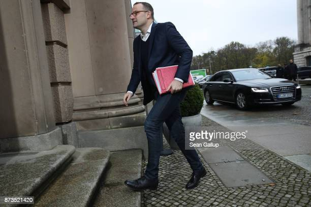 Jens Spahn of the German Christian Democrats arrives for yet another round of preliminary coalition talks for the creation of a new government on...