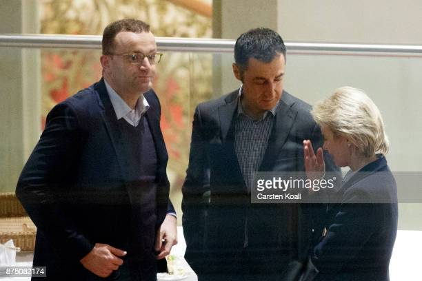 Jens Spahn of the German Christian Democrats Cem Oezdemir coleader of German Greens Party and German Defense Minister Ursula von der Leyen discuss...