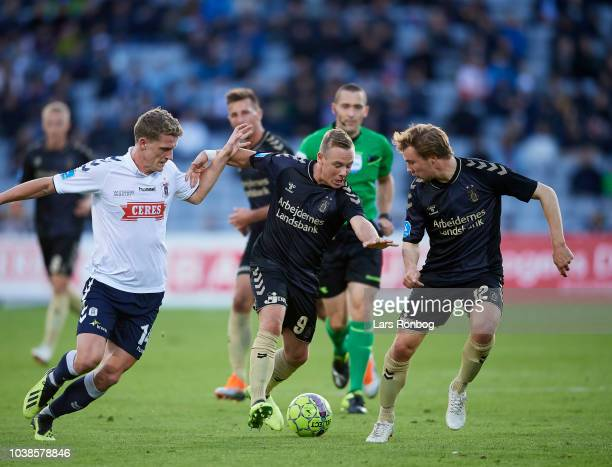 Jens Stage of AGF Aarhus Uffe Bech of Brondby IF and Simon Tibbling of Brondby IF compete for the ball during the Danish Superliga match between AGF...