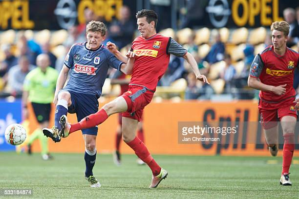 Jens Stage of AGF Arhus and Pascal Gregor of FC Nordsjalland compete for the ball during the Danish Alka Superliga match between FC Nordsjalland and...