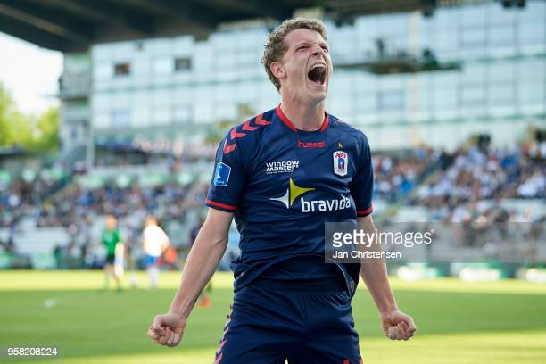 Jens Stage of AGF Arhus celebrate after the 02 goal from Bror Blume of AGF Arhus during during the Danish Alka Superliga match between OB Odense and...
