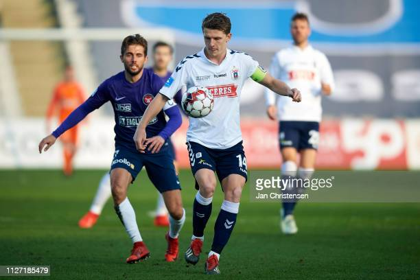 Jens Stage of AGF Arhus compete for the ball during the Danish Superliga match between AGF Arhus and FC Midtjylland at Ceres Park on February 24 2019...