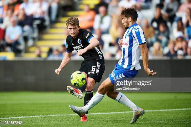 Jens Stage of FC Copenhagen and Alexander Juel Andersen of OB Odense compete for the ball during the Danish 3F Superliga match between OB Odense and...