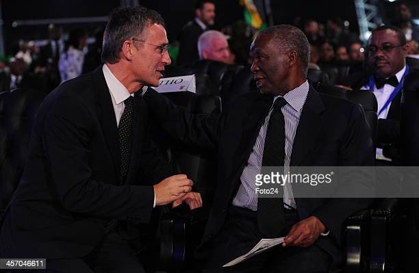 Jens Stoltenberg a former Norwegian Prime Minister speaks with Thabo Mbeki at Madiba's State Funeral on December 15 2013 in Qunu South Africa Nelson...
