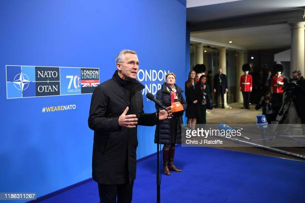 Jens Stoltenberg Secretary General of NATO speaks to press as World leaders arrive for the NATO summit at the Grove Hotel on December 4 2019 in...