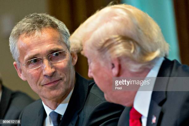 Jens Stoltenberg secretary general of the North Atlantic Treaty Organization listens as US President Donald Trump right speaks during a meeting in...