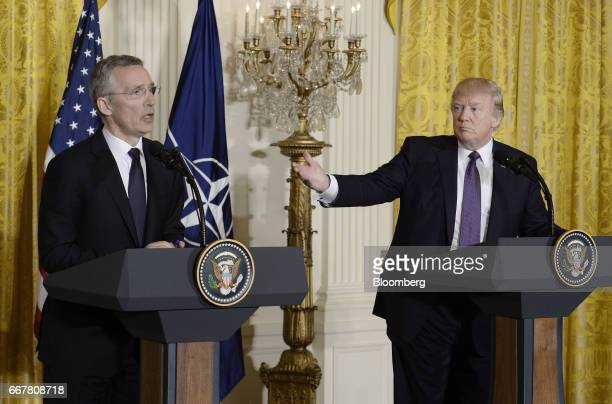 Jens Stoltenberg secretary general of the North Atlantic Treaty Organization left speaks as US President Donald Trump gestures during a joint press...