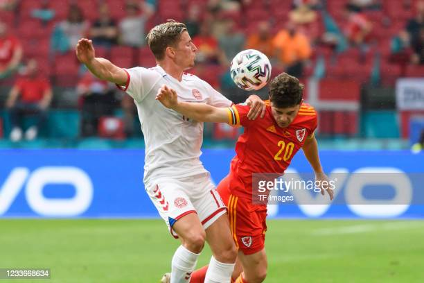 Jens Stryger Larsen of Denmark and Daniel James of Wales battle for the ball during the UEFA Euro 2020 Championship Round of 16 match between Wales...