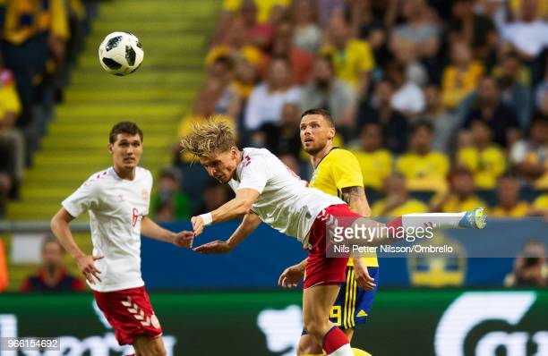 Jens Stryger Larsen of Denmark and Marcus Berg of Sweden competes for the ball during the International Friendly match between Sweden and Denmark at...