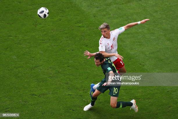 Jens Stryger Larsen of Denmark wins a header over Robbie Kruse of Australia during the 2018 FIFA World Cup Russia group C match between Denmark and...
