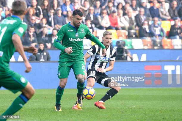 Jens Stryger Larsen of Udinese Calcio competes with Andrea Petagna of Atalanta BC during the Serie A match between Udinese Calcio and Atalanta BC at...