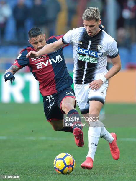Jens Stryger of Udinese Calcio competes for the ball with Gianluca Lapadula of Genoa CFC during the serie A match between Genoa CFC and Udinese...