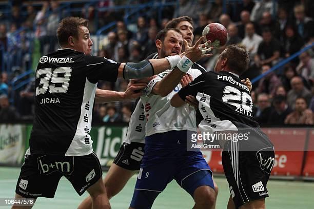 Jens Tiedtke of Grosswallstadt is challenged by Filip Jicha Marcus Ahlm and Christian Zeitz of Kiel during the Toyota Handball Bundesliga match...