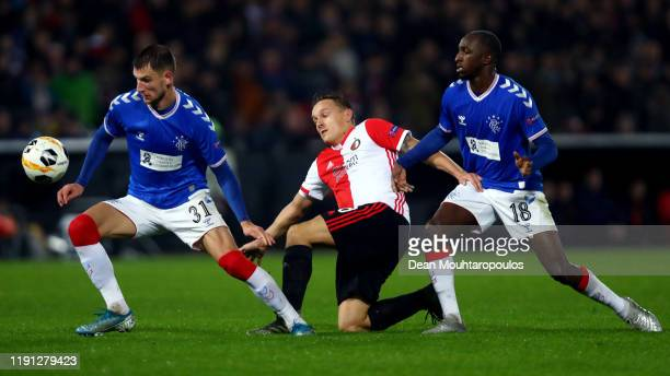 Jens Toornstra of Feyenoord battles for the ball with Borna Barisic and Glen Kamara of Rangers FC during the UEFA Europa League group G match between...