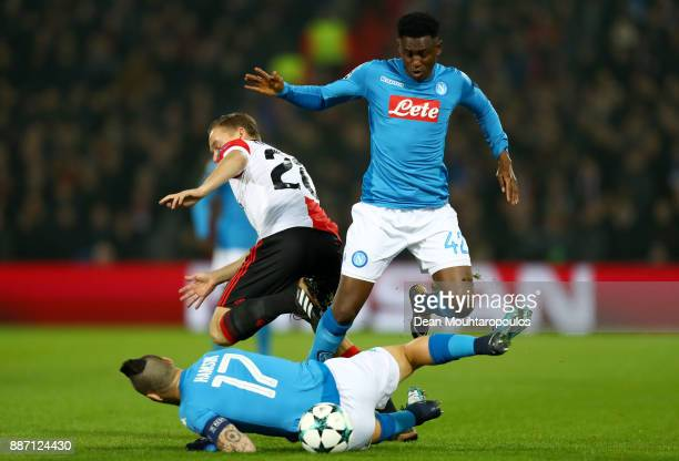 Jens Toornstra of Feyenoord challenges for the ball with Marek Hamsik of SSC Napoli and Amadou Diawara of SSC Napoli during the UEFA Champions League...