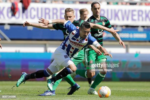 Jens Toornstra of Feyenoord Reza Ghoochannejhad of SC Heerenveen Sofyan Amrabat of Feyenoord during the Dutch Eredivisie match between SC Heerenveen...