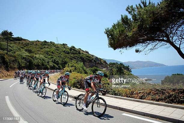 Jens Voigt of Germany and Radioshack Leopard leads the peloton along the Corsican coast during stage three of the 2013 Tour de France, a 145.5KM road...