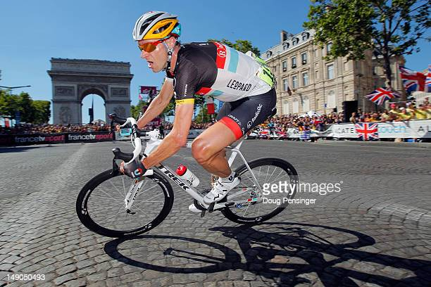 Jens Voigt of Germany and RadioshackNissan breaks away from the peloton and rounds the Arc d'Triomphe during the twentieth and final stage of the...