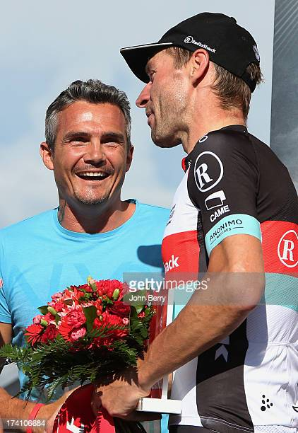Jens Voigt of Germany and Team Radioshack Leopard here congratulated by Richard Virenque wins the most combative rider trophy after stage twenty of...