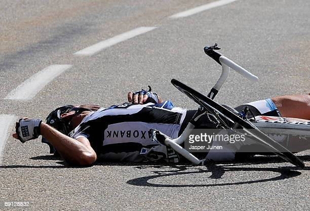 Jens Voigt of Germany and team Saxo Bank lies on the road after in the descend of the Col du Petit-Saint-Bernard during stage 16 of the 2009 Tour de...